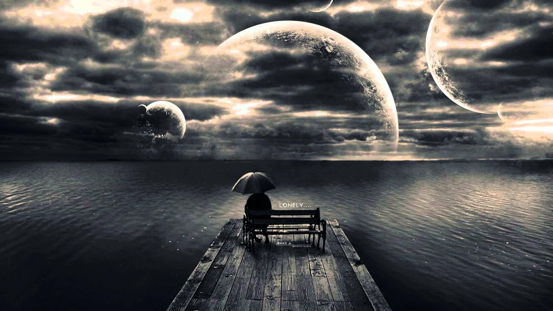 Hình nền cô đơn một mình ngồi đó giữa thế giới