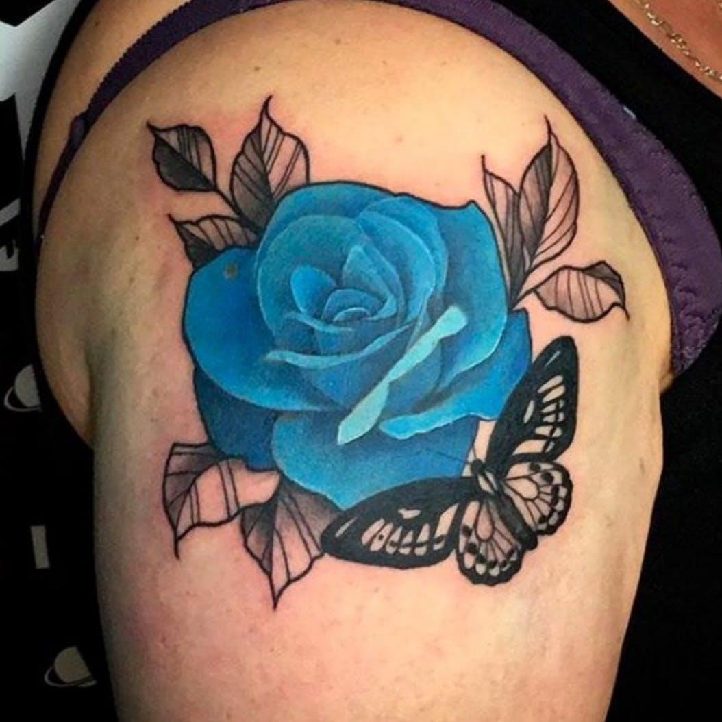 Hình xăm hoa hồng xanh trên vai