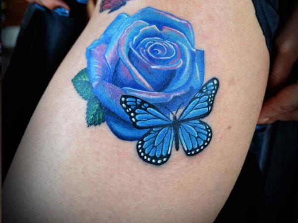 Hình xăm hoa hồng xanh và con bướm