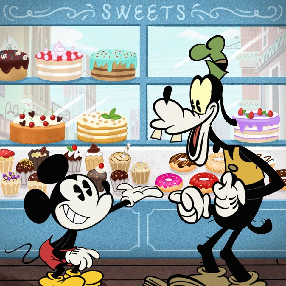 Chuột Mickey mời bạn chó ăn bánh ngọt
