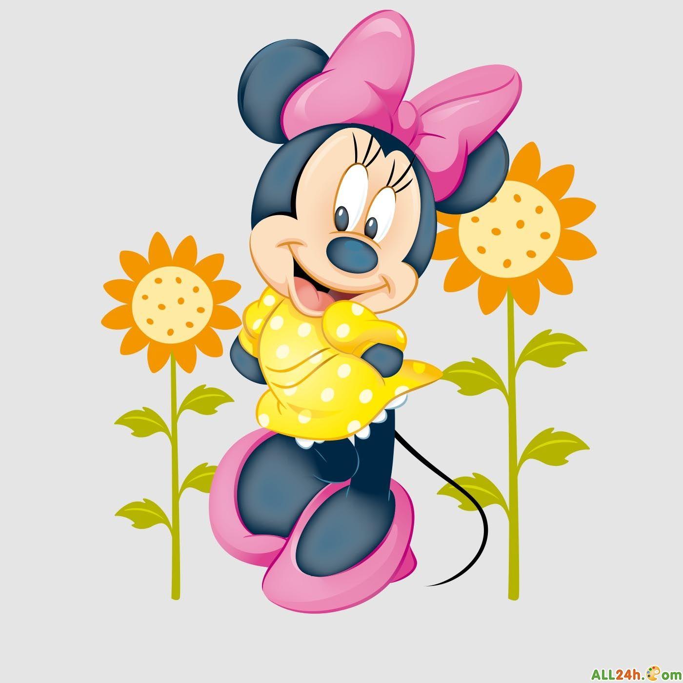 Chuột Mickey nữ đứng cạnh cây hoa hướng dương