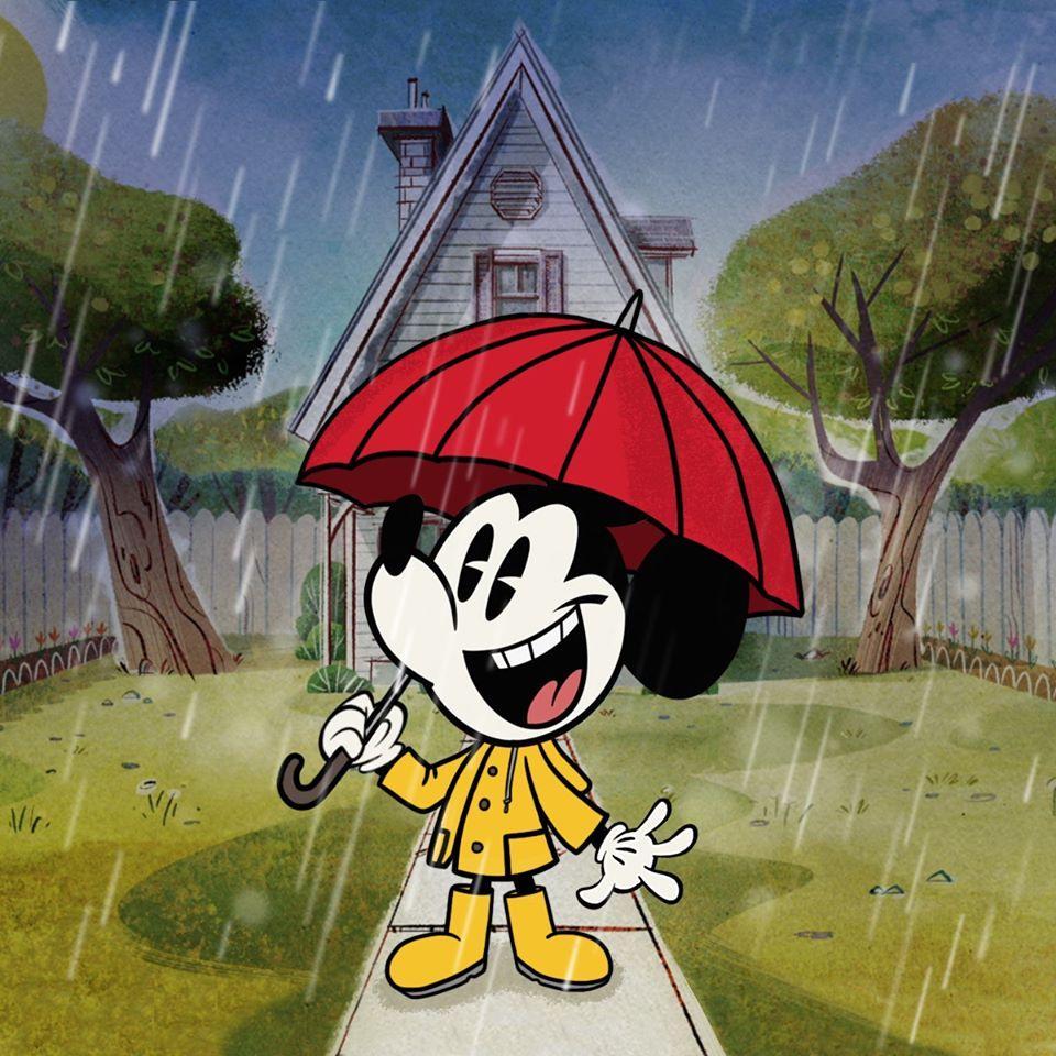 Chuột Mickey vui vẻ đứng dưới mưa