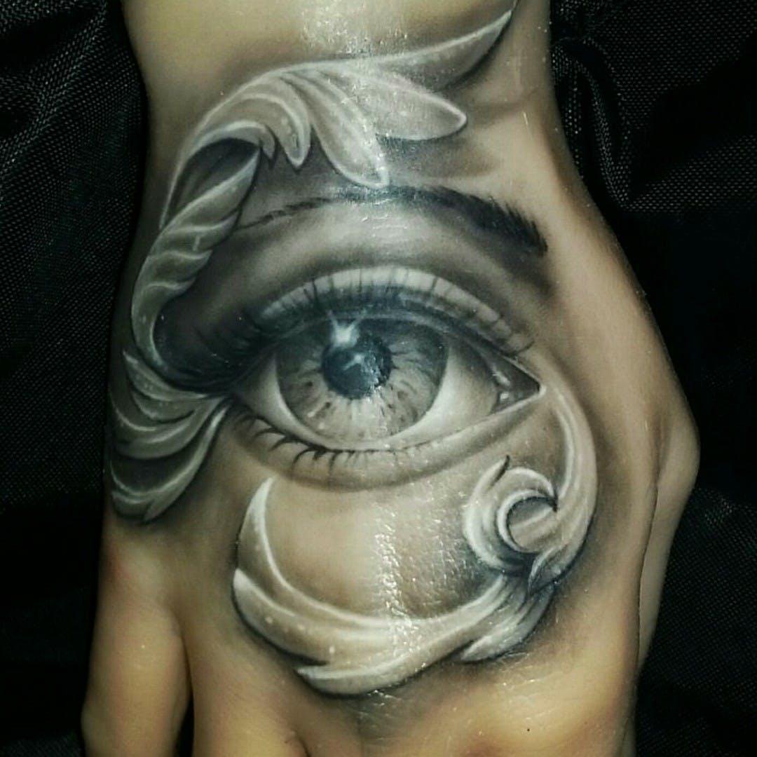 Hình xăm con mắt ngàn năm ở bàn tay đẹp nhất