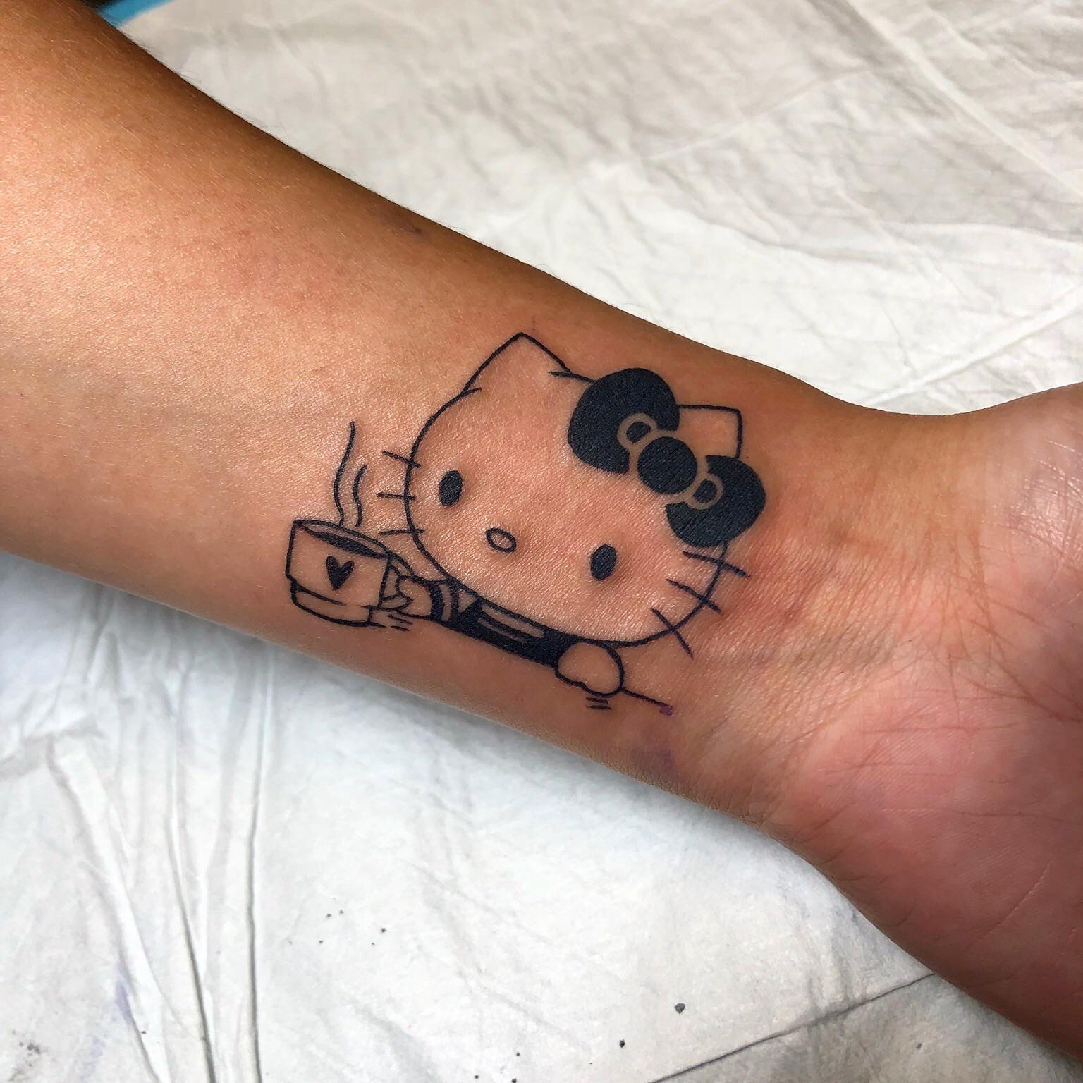 Xăm hình Hello Kitty đáng yêu và dễ thương nhất
