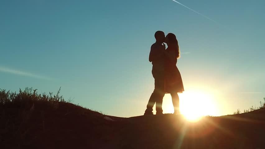 Couple at Sunset Kiss