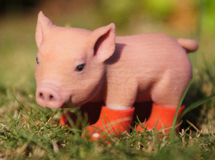 Hình ảnh chú lợn đi ủng đỏ dễ thương