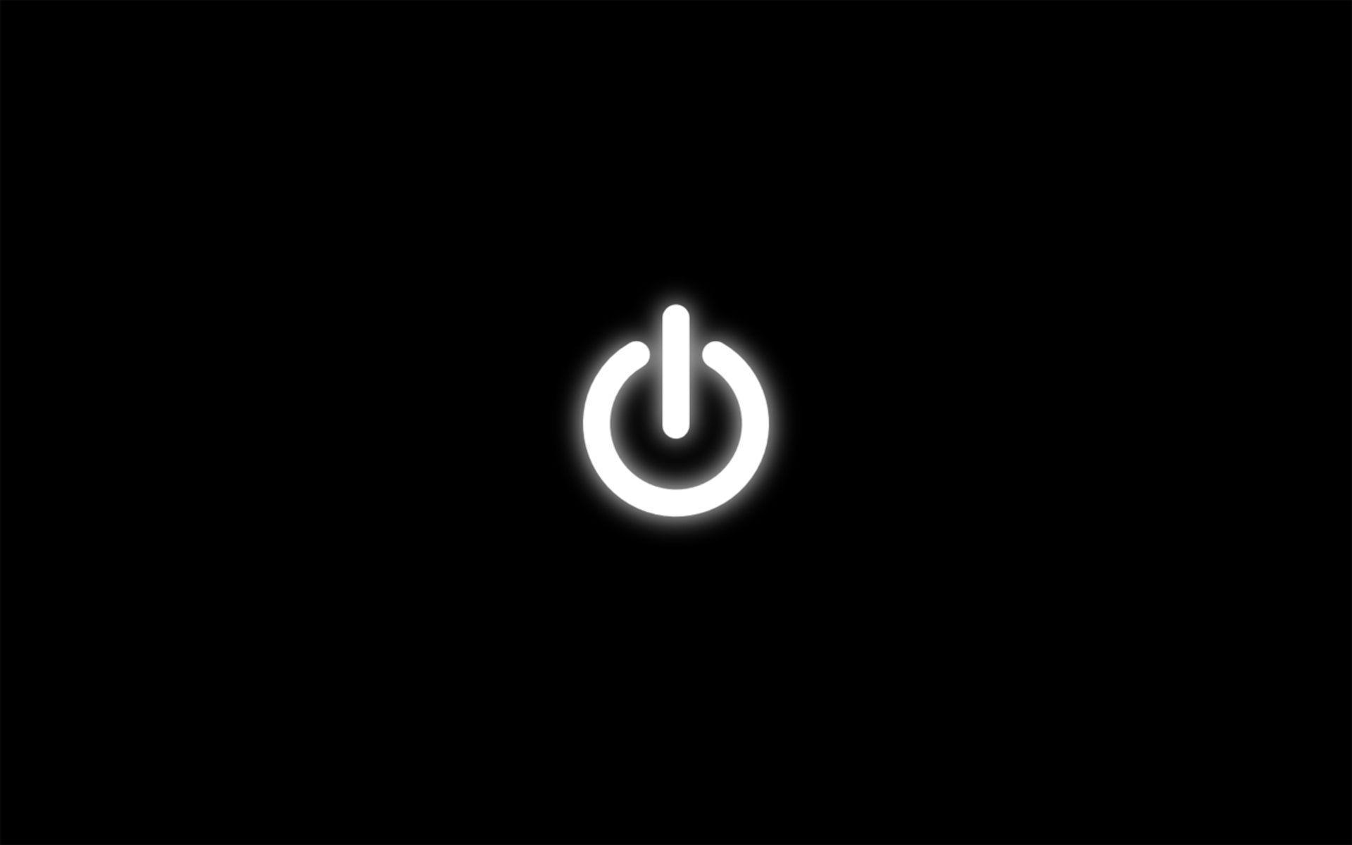 Hình nền đen cho máy tính với nút nguồn trắng ở chính giữa
