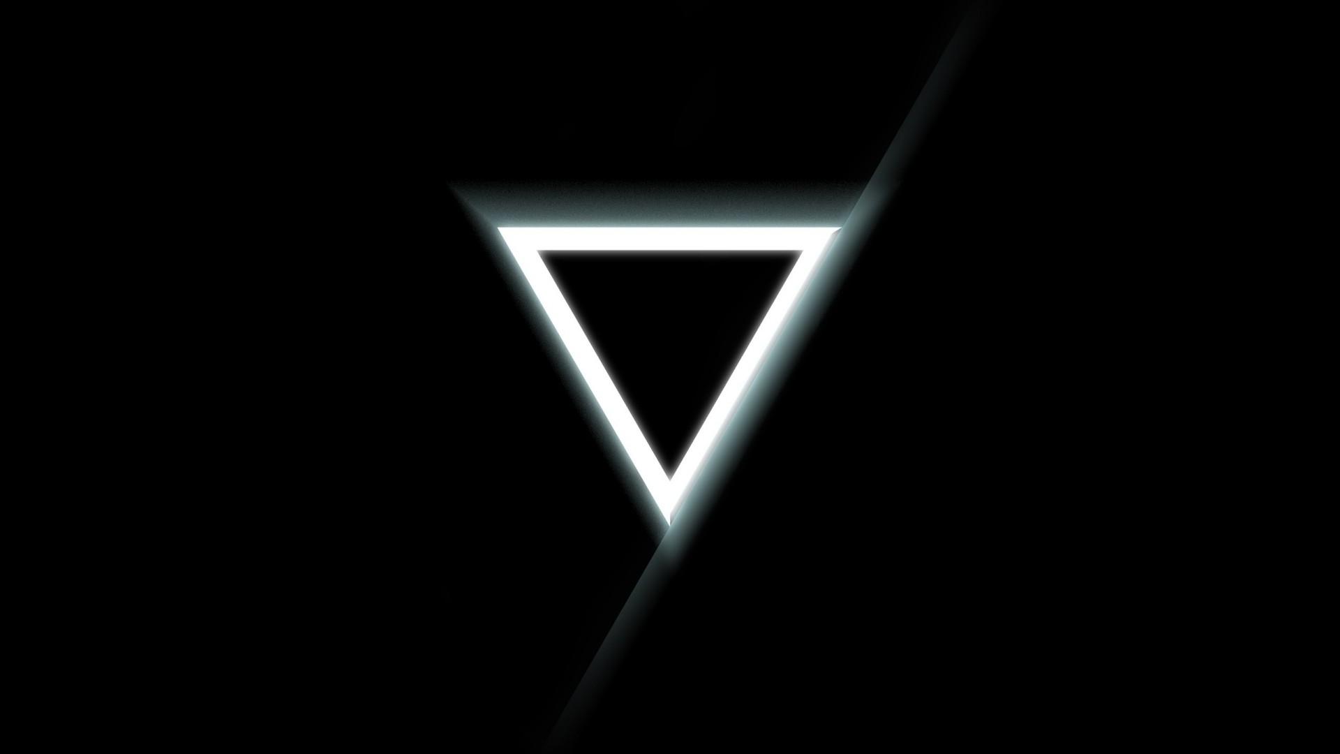 Hình nền đen tam giác phát sáng