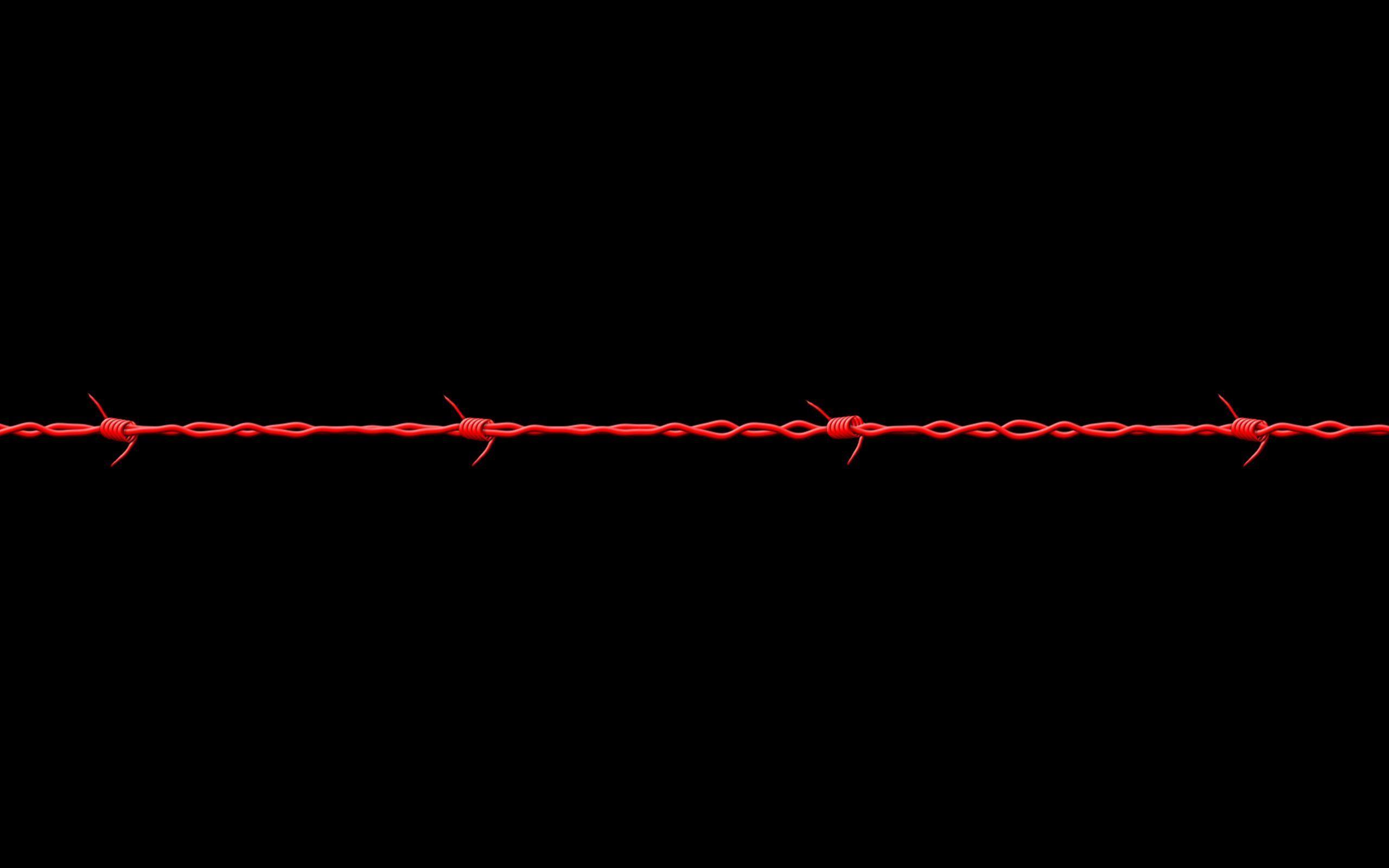 Hình nền đen và sợi thép gai đỏ