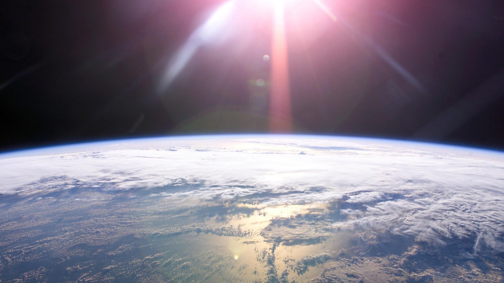 Hình nền mặt trời và trái đất