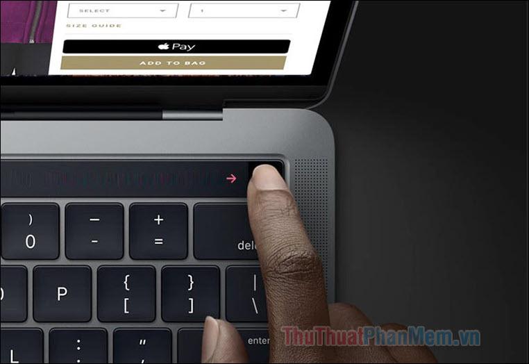 Nhấn giữ vào nút cảm biết ở góc ngoài cùng bên phải của thanh Touchbar